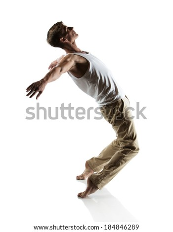 Adult caucasian male dancer wearing a white shirt and beige pants. Image is isolated on a white background.