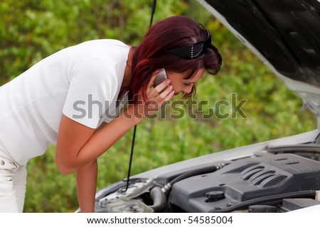 Adult caucasian woman in her car breaks down. Engine failure. - stock photo