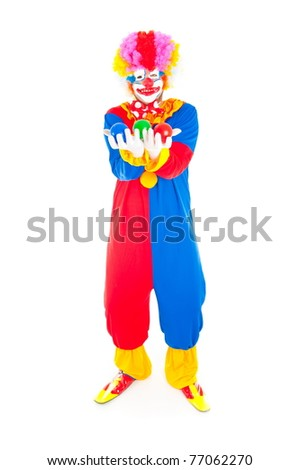 Adult Clown smiling holding colors balls