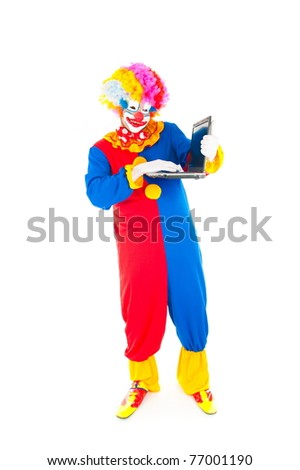 Adult Clown using a laptop on white .