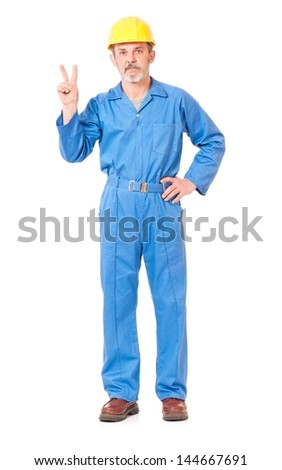 Adult contractor shows victory gesture isolated on white background - stock photo