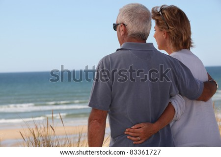 Adult couple at the beach - stock photo