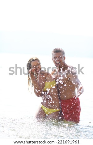 Adult couple having fun in water - stock photo