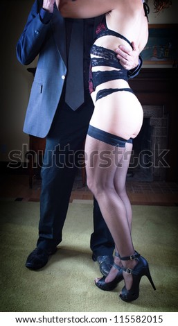 Adult couple having some fun time together - stock photo