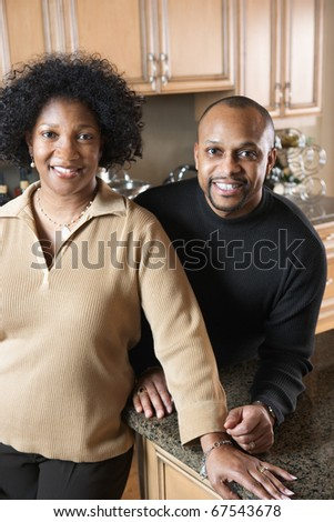 Adult couple smiling at camera - stock photo