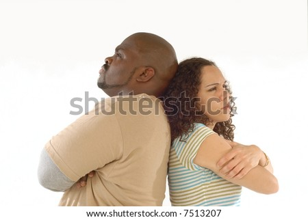 Adult couple upset with each other and looking stubbornly away - stock photo