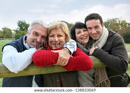 Adult couples in the countryside - stock photo