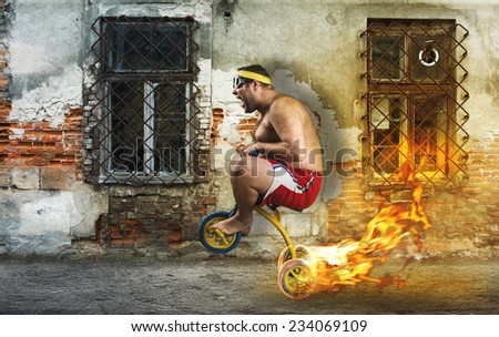 Adult crazy man cycling on child's bicycle - stock photo