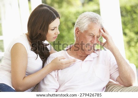 Adult Daughter Talking To Depressed Senior Father - stock photo