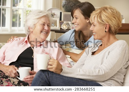 Adult Daughter With Teenage Granddaughter Visiting Grandmother - stock photo