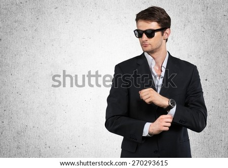 Adult. Elegant young handsome man wearing glasses and watchers. Studio fashion portrait. - stock photo