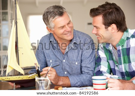 Adult father and son model making - stock photo