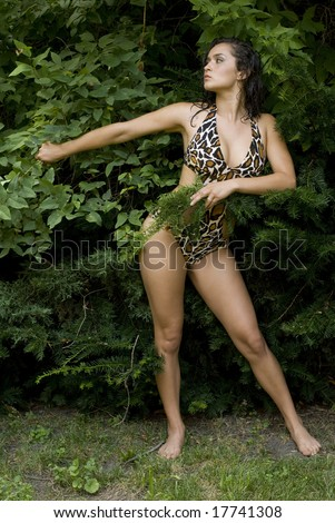 Adult female wearing an animal print bathing suit with no shoes - stock photo