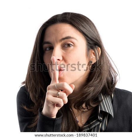 Adult girl making silence gesture over isolated white background