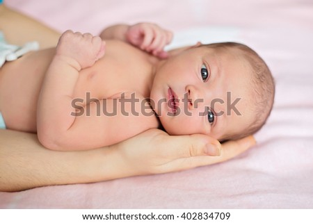 Adult Hands holding newborn baby with white background - stock photo