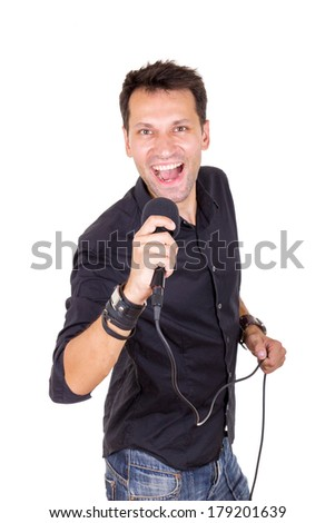 adult handsome man with microphone singing  - stock photo