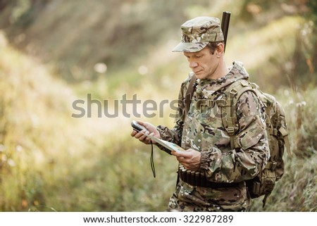 adult hunter determine the route on the gps navigator