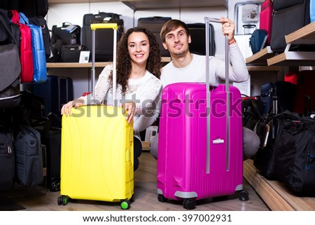 Adult husband and wife selecting handy trunk in store