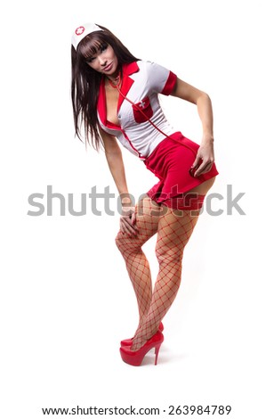 Adult image. sexy brunette in white and red costume nurse with a stethoscope in her hands. Role play. Entertainment. - stock photo