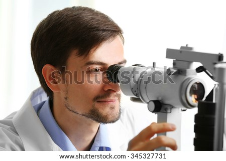 Adult male doctor examing a patient - stock photo