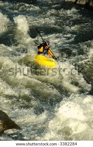 adult male in yellow kayak descending narrow whitewater section of Eagle River - stock photo