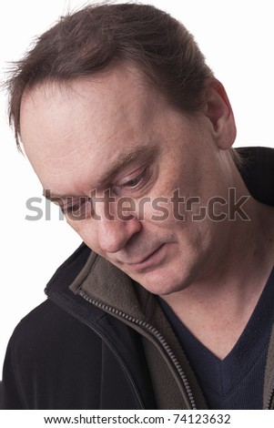 adult male staring at the ground against a white background - stock photo