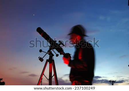 Adult man and telescope with camera. Near Kiev,Ukraine