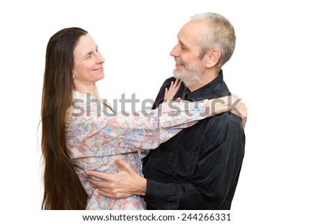 Adult man and woman with long hair looking at each other with love, eyes in eyes, for S. Valentine's day or anniversary. Isolated on white background.