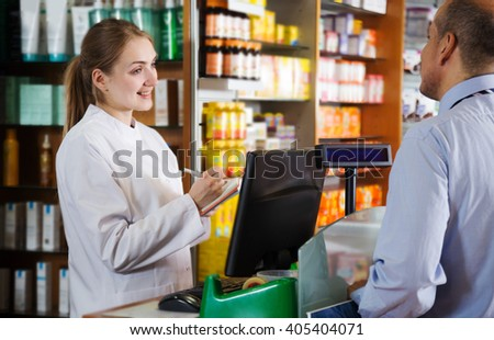 Adult man buys medicine in a pharmacy - stock photo