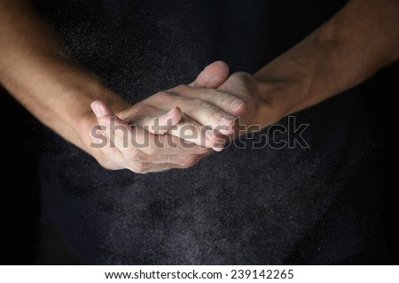 adult man hands work with flour, dark photo