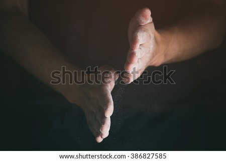 adult man hands working with flour closeup, vintage toned photo - stock photo