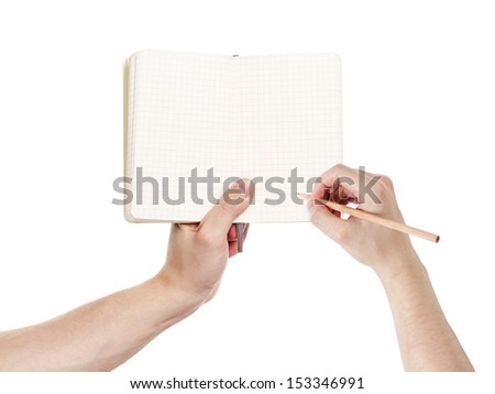 adult man hands writing something in notepad, isolated - stock photo