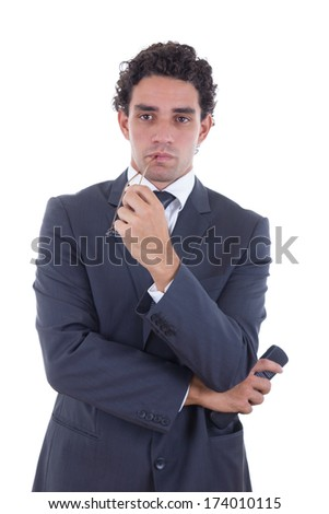 adult man in suit holding the remote while watching TV - stock photo