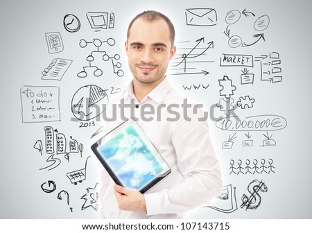 Adult man planning and working using his tablet computer - stock photo