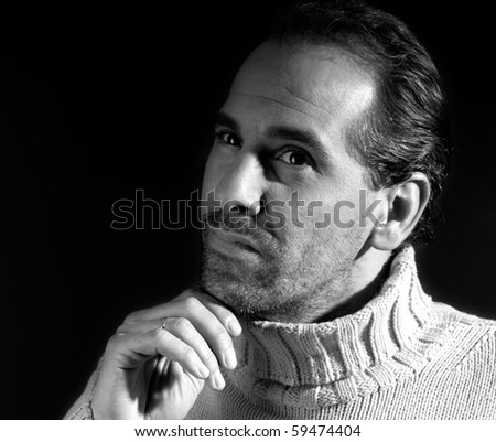 Adult man portrait thinking expression on black and white - stock photo