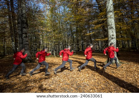 Adult man running through the woods in the morning - stock photo