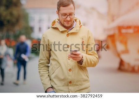 adult man speaks on the phone and writing text - stock photo