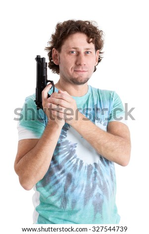 Adult man standing with black gun in hands, looking at camera, isolated on black background - stock photo