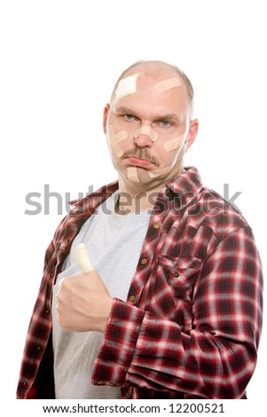 Adult man standing with his head covered in bandaids looking sad - stock photo