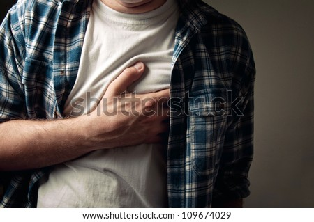 Adult man suffering from severe heartache. - stock photo