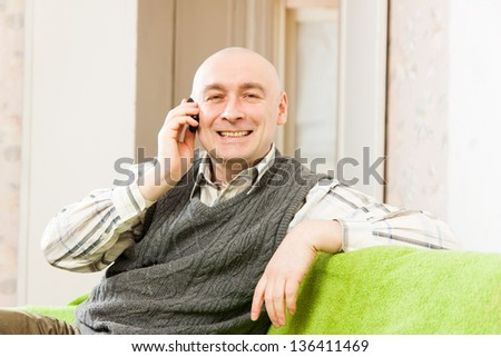adult man talking on the sofa at home