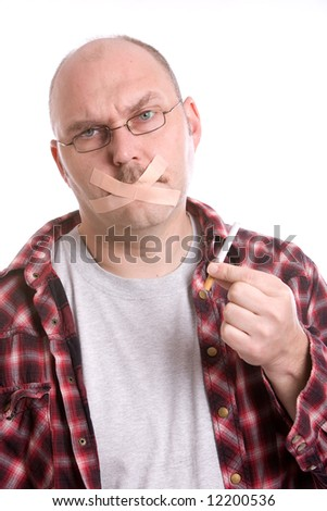 Adult man trying to quit smoking with bandaids on his mouth - stock photo