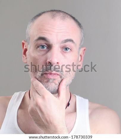 adult man unshaven gray facial wrinkles