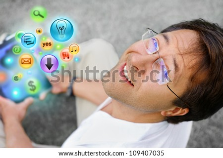 Adult man using his tablet computer to do his tasks everywhere - stock photo