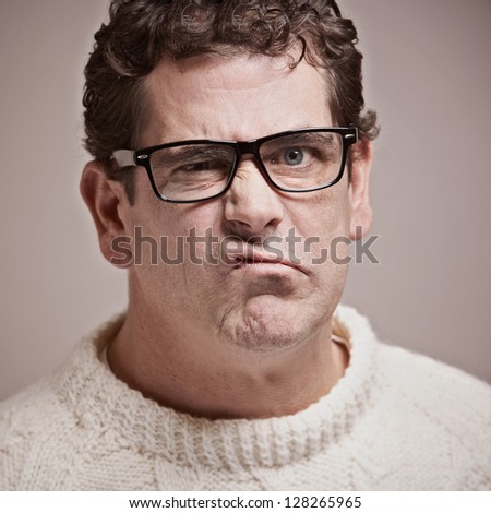 Adult man with funny upset expression closeup - stock photo
