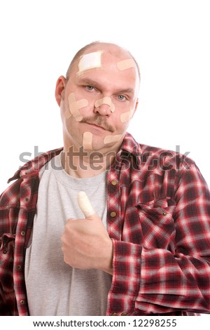 adult man with his head covered in bandaids and his thumb wrapped