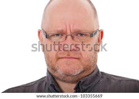 Adult man with severe look. All on white background.