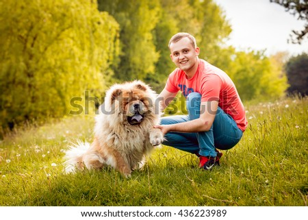 Adult man with the dogs in the park. - stock photo