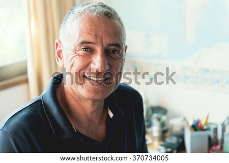 Adult middle age man, working at home office. - stock photo