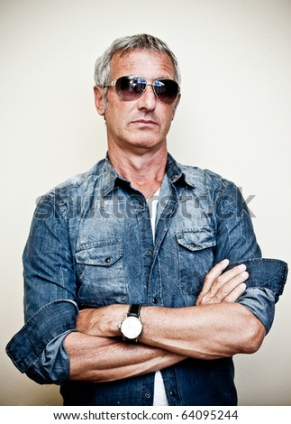 Adult model wearing sunglasses - stock photo
